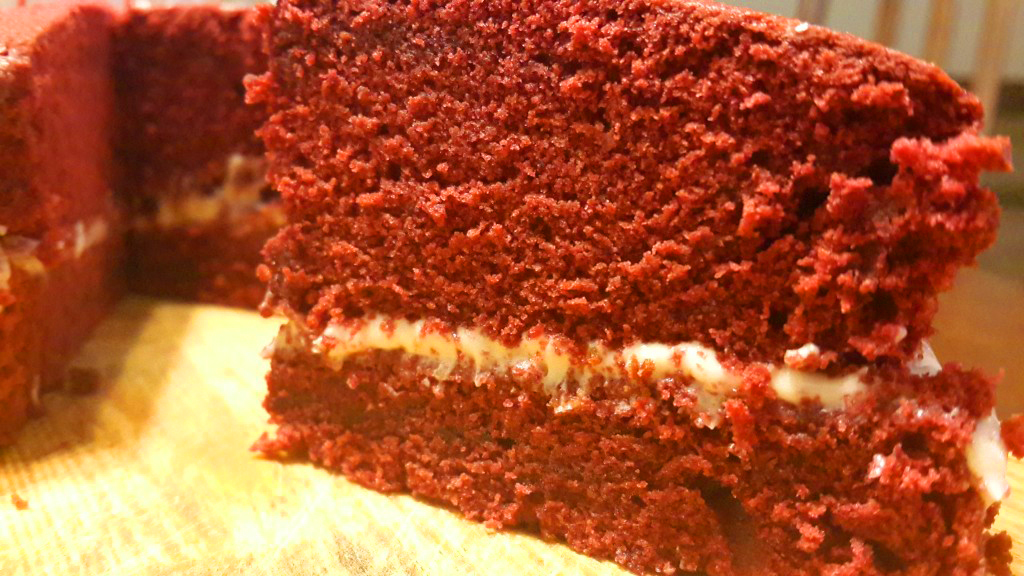 A slice of red velvet cake