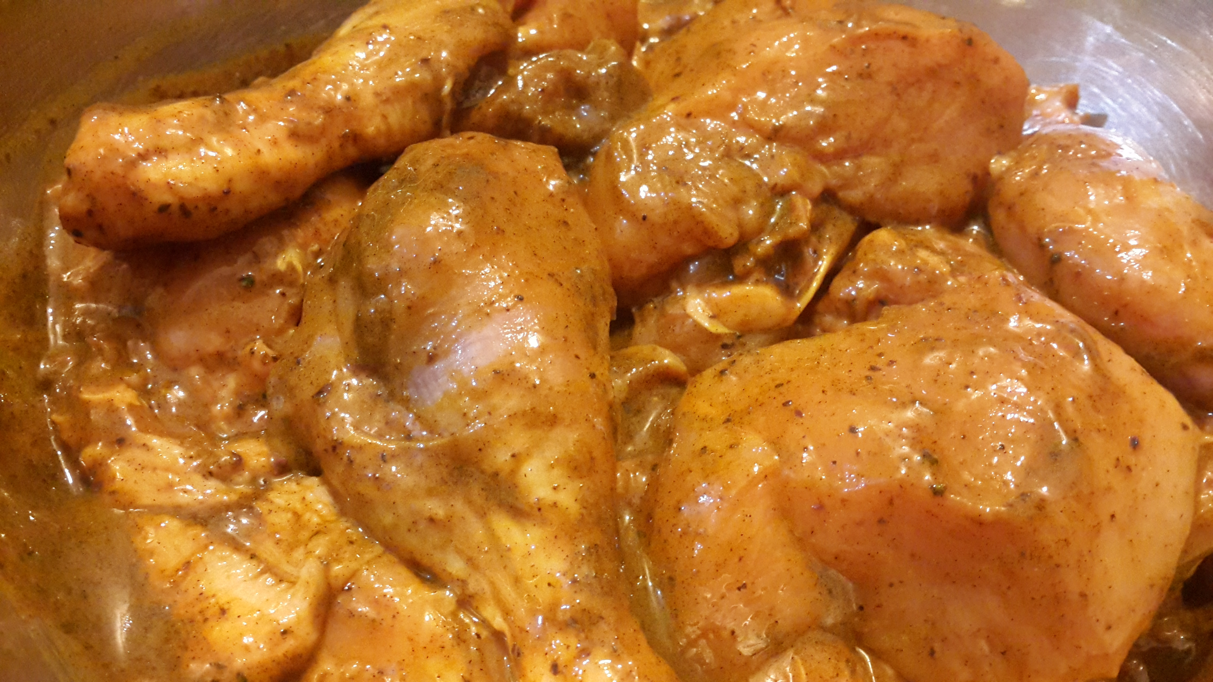 Chicken marinating in turmeric powder, 8 - 9 sauce and salt