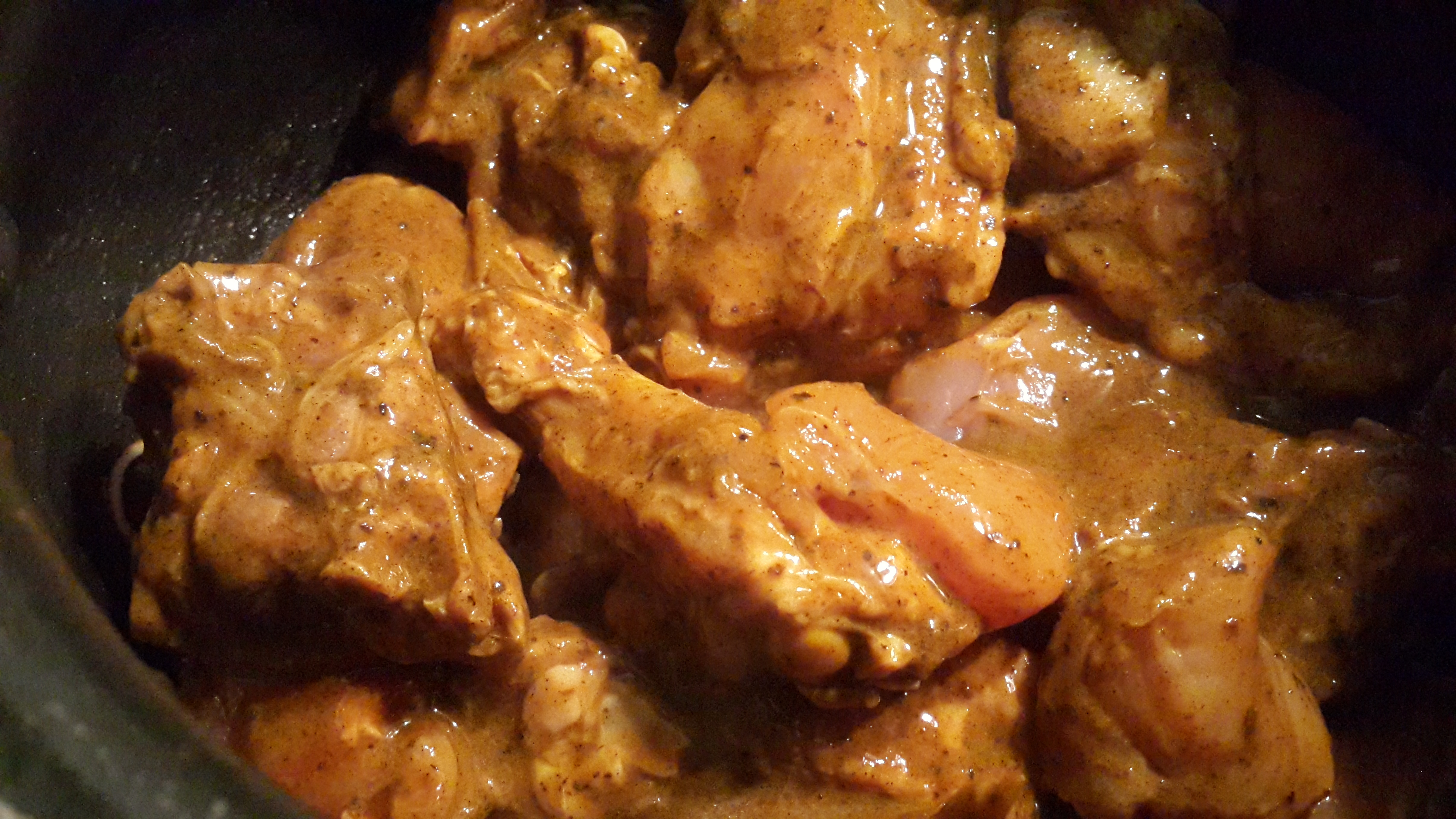 Marinated chicken placed over the sauteed onions
