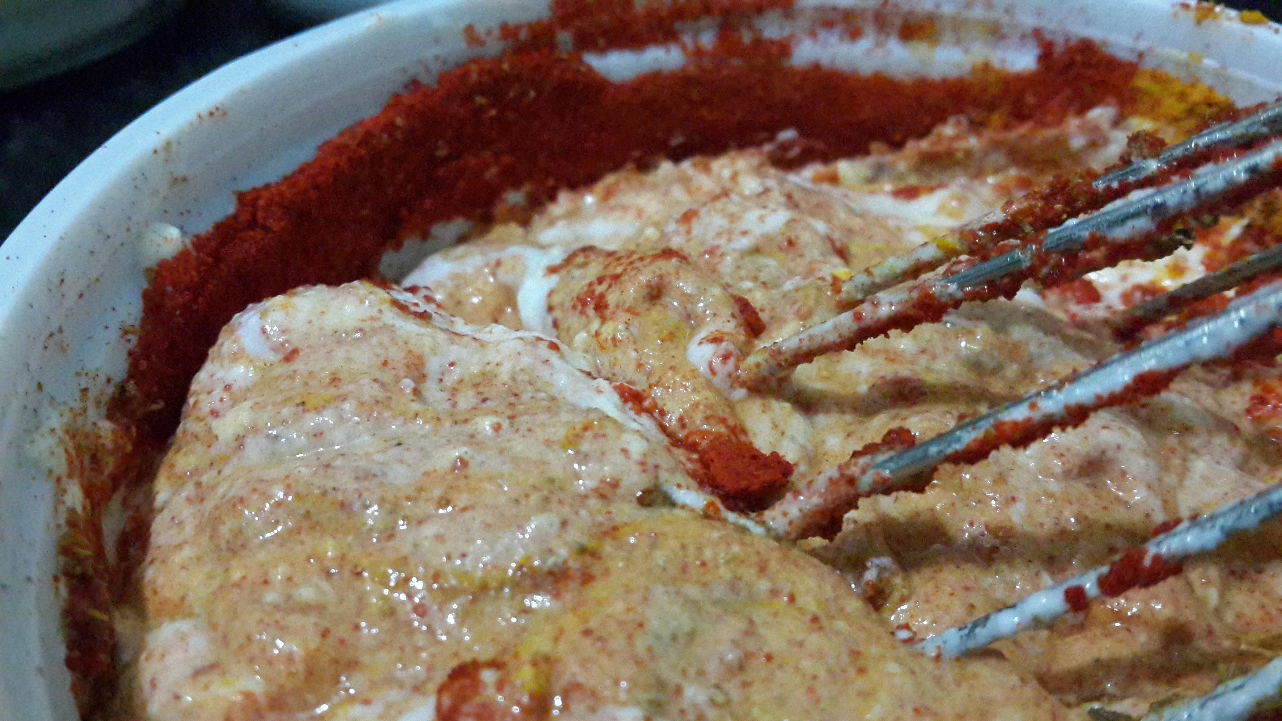 Curd whisked with red chilli powder, coriander powder, cumin powder and salt